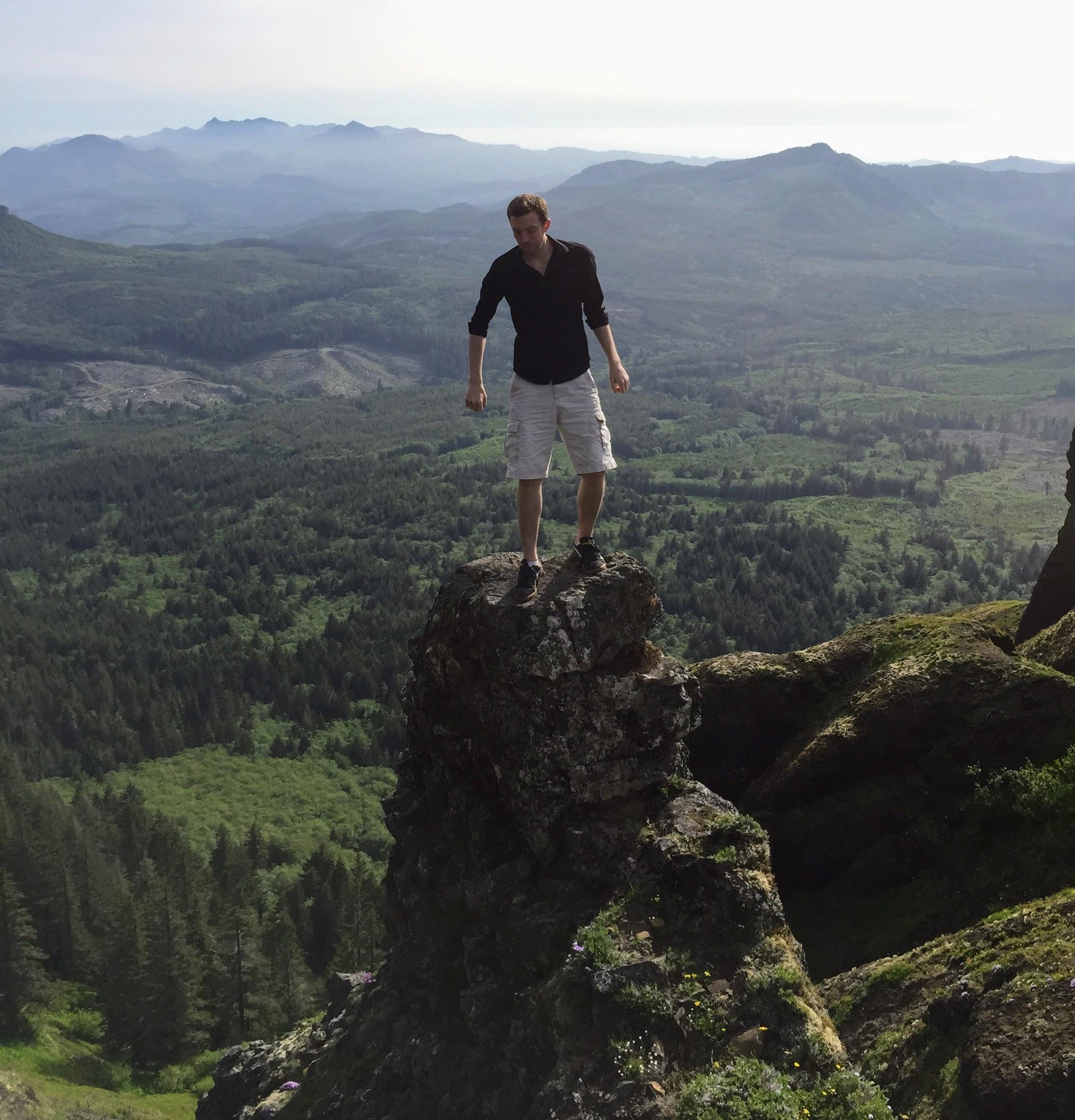 Man standing on peak