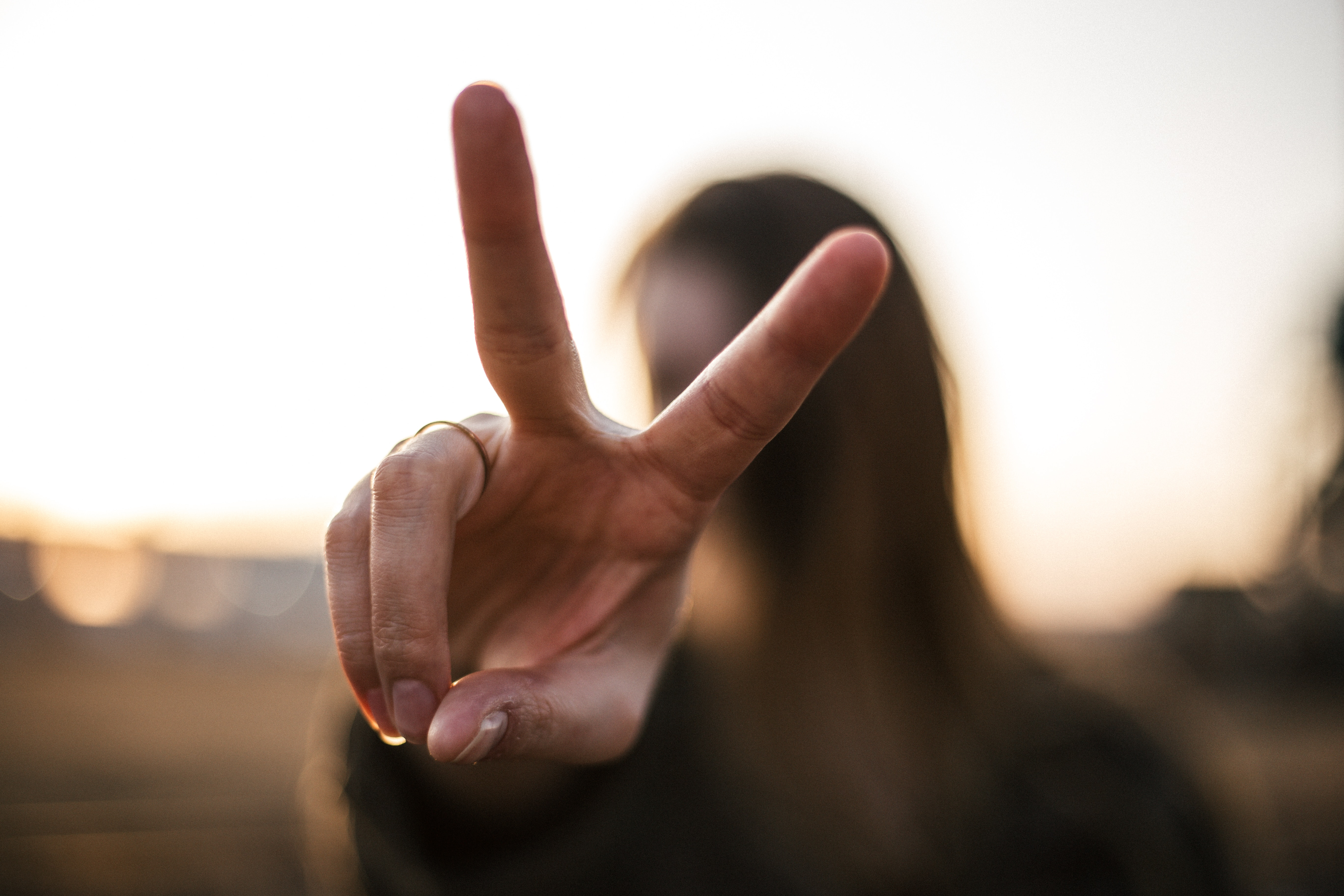 Image of Woman Giving A Peace Sign